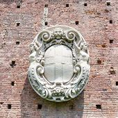 Coat of arms bas-relief on the wall of Sforza castle in Milan Italy.