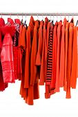Set of red fashion female clothing hanging a on display
