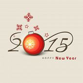 Happy New Year 2015 celebrations with stylish text and snowflake decorated Christmas ball on beige b
