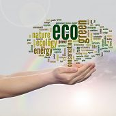 Concept or conceptual abstract green ecology, conservation word cloud text in man hand, rainbow sky