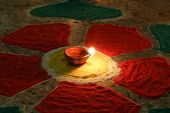 pic of rangoli  - oil lamp with colorful rangoli, diwali festival