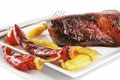 grilled chunk of beef meat with tomato and peppers