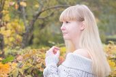 Blonde Girl  In The Autumn Park