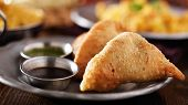 picture of samosa  - indian samosa with mint and hot chutney panorama - JPG