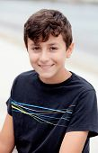 Nice preteen boy smiling with a black t-shirt