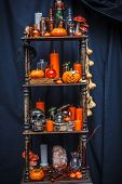 Old Shelves With Items To Celebrate Halloween
