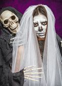 foto of day dead skull  - Young woman a bride in a veil day of the dead mask skull face art and skeleton - JPG