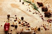Spices on table with spoon silhouette, close-up