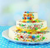 Beautiful tasty birthday cake on light background