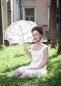 Beautiful Young Gothic Girl In White Shirt With Umbrella