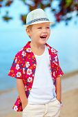 Portrait Of Funny Laughing Boy On The Beach