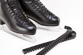 Professional Mens Figure Skates With Blade Covers Together. Over White Background