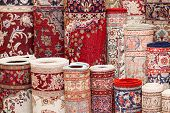 foto of carpet  - Close up of various handmade Persian carpets in a shop - JPG