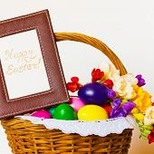 picture of terrific  - beautiful easter eggs and flowers freesia in wicker basket with frame inscription text - JPG
