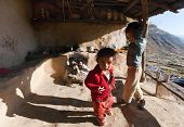 Children In Typical Nepalese Kitchen