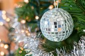 Christmas ball with mirrors hanging in tree