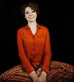 Woman wearing orange shirt