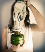 Woman holding gas mask
