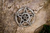 foto of pentagram  - Old steel Pentagram closeup photo on background - JPG