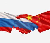Chinese An Russian Flags With A Handshake