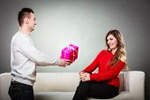 Happy Romantic Couple With Gift