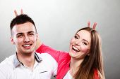 Funny Young Couple Portrait On Gray