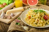 image of oven  - Semolina pasta with roasted garlic sprinkled microherbs fresh and tasty garlic baked in the oven  - JPG