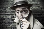 picture of trench coat  - Funny vintage detective looking through a magnifier - JPG