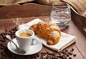 Espresso With Croissant And Glass Of Water.