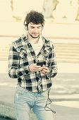 Man Walking In The Street With Smartphone