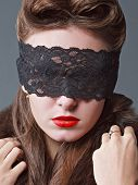 Portrait Of A Charming Woman In Black Lace Mask.
