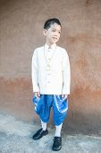 stock photo of character traits  - Asian lovely boy wearing national dress - JPG