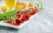 fresh beef cuts, carpaccio, with vegetables and basil