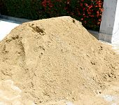 picture of sand gravel  - The sand is placed in front of the building used for the construction of buildings - JPG