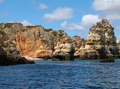 stock photo of lagos  - Cliffs and small beach on the coast of Lagos Algarve Portugal - JPG