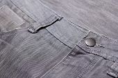 Close Up Of Button On Washed Grey Jeans