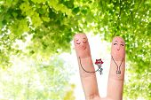 Conceptual Finger Art Of A Happy Couple. Man Is Giving A Bouquet. Stock Image