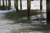 Wooden pier and ocean water underneath