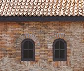 Dark Brown Painted Wood Arched Window In A Red Brick Wall