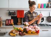 pic of pickled vegetables  - Happy young housewife with jars of pickled vegetables - JPG