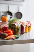 pic of pickled vegetables  - Closeup on jars of pickled vegetables on table - JPG