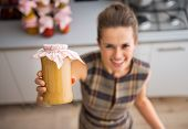 Closeup On Happy Young Housewife Showing Jar With Homemade Apple