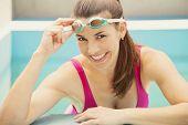 Happy woman in swimming pool