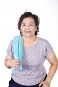 Old Asian Woman Smiling After Workout, Holding Towel Around Neck, Isolated On White Background
