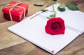 Red Rose On Notebook ,gift Box On Wood Background