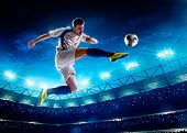 pic of shoot out  - Soccer player in action on night stadium background - JPG