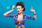 pin-up girl with the broken glass and cigarette