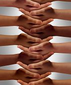 foto of achievement  - Support network concept and people power from a multicultural society working together with respect to help one another achieve community success as a group of connected hands holding each other - JPG