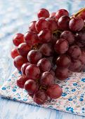 Fresh Red Grapes Over Blue Background