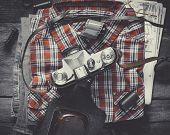 Plaid Shirt, Pair Of Jeans And Old Film Camera. Top View.